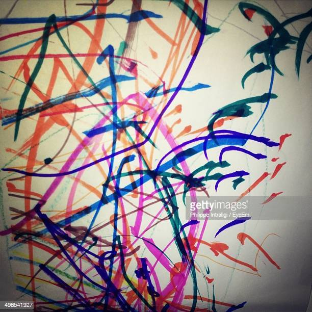 Abstract image of multicolored lines drawn on paper