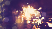 Abstract sparklers with romantic city light vintage color tone process style for christmas and happy new year celebrate holiday background