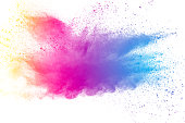 Abstract multicolored powder splatter on white background.