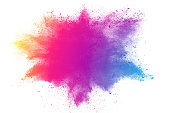 abstract multicolored powder splattered on white background,Freeze motion of color powder explosion.