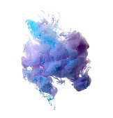 Abstract of blue and brown acrylic paint in water. Studio photography on a white background.
