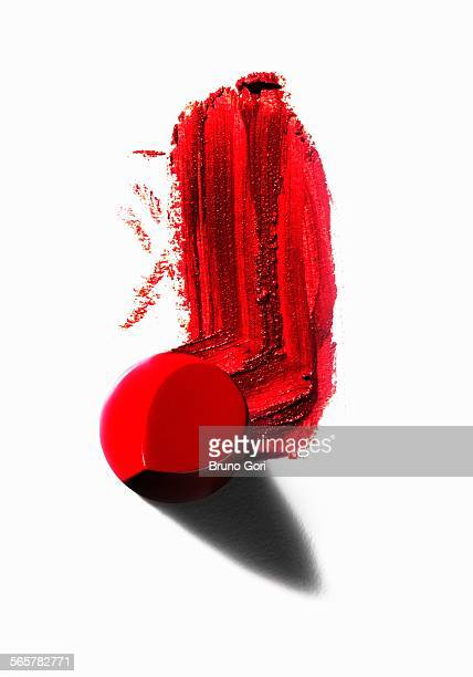 Abstract of piece of red lipstick with smudged line