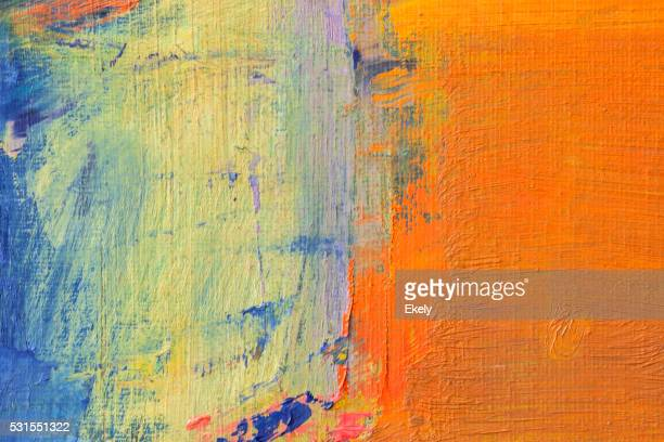 Abstract painted orange green and blue art backgrounds.