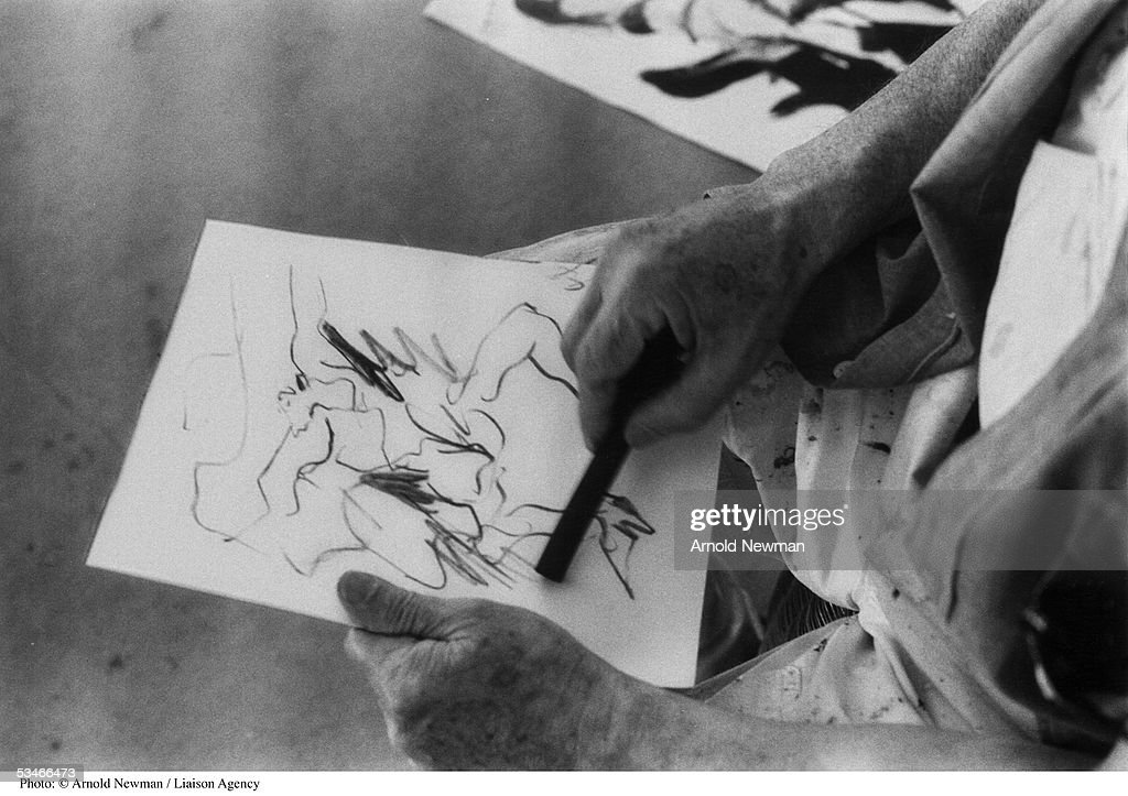 Abstract painter Willem De Kooning drawing in his studio December 17, 1978 in Springs, New York.