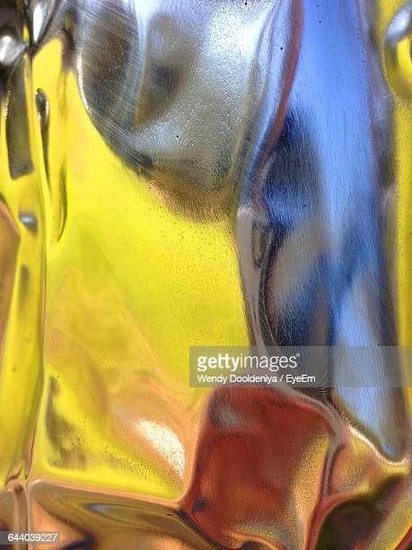 Abstract Pattern Viewed On Reflection On Metal Surface
