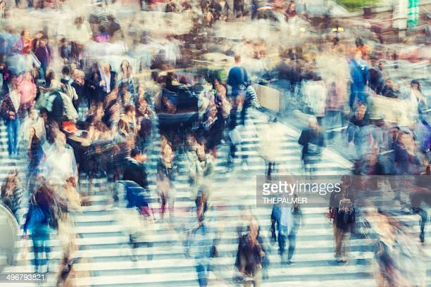abstract people walking during rush hour