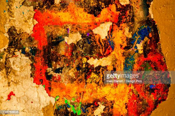 Abstract photo of peeling paint on a concrete wall