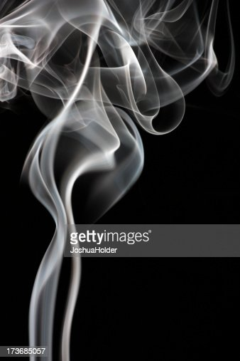 Abstract photo of smoke in front of a black backdrop