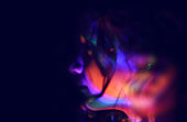 abstract portrait of young girl under colorful fluorescent Neon dark lights, enigmatic style