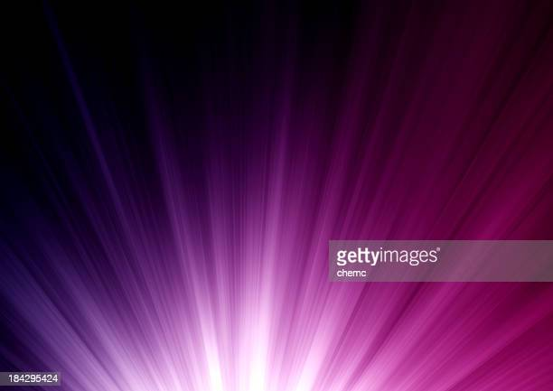 Abstract purple to pink color burst on black background