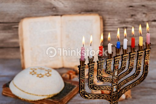Abstract retro filtered low key image of jewish holiday Hanukkah with menorah traditional Candelabra