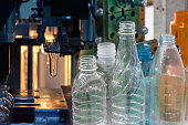 Abstract scene of  blowing bottle process  and  plastic bottle product. The Plastic bottle manufacturing process.