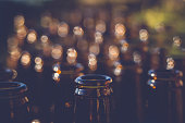 Abstract shot of Rows of beer bottles with bokeh