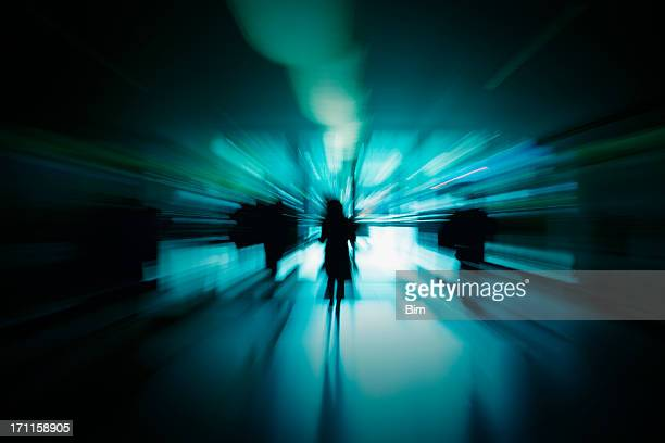 Abstract Silhouettes of People in Blue Corridor, Blurred Motion