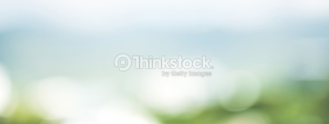 Abstract simple clean natural blur white green bokeh background with light blue shade in the middle : Stock Photo