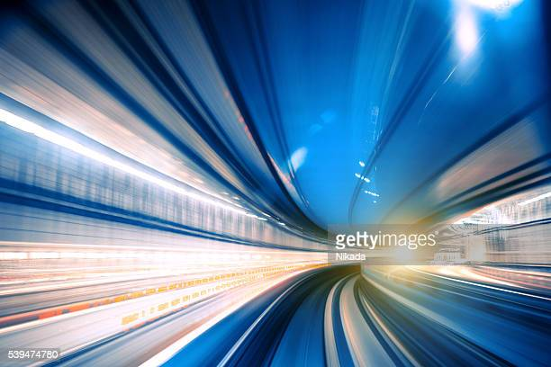 Abstract Speed motion through a tunnel