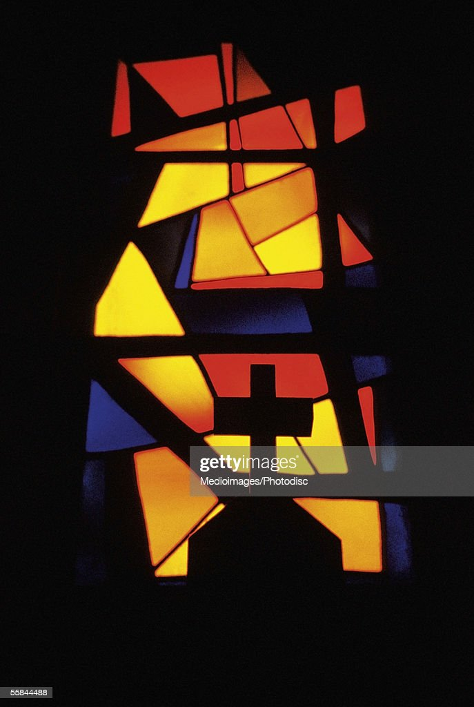 Abstract stained glass window and a cross, Church of the Annunciation, Nazareth, Israel