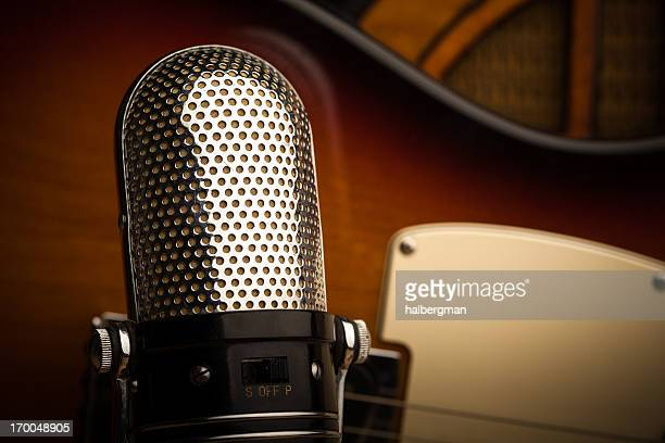Abstract Still Life of Classic Microphone, Guitar, and Radio