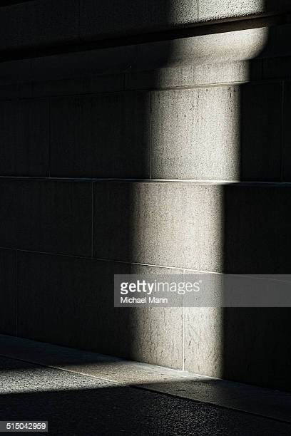 Abstract view of shadow and light against building