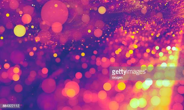 Abstract violet and pink bokeh sparkling spray circle