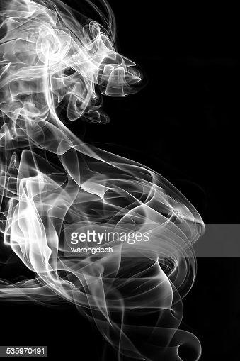 Abstract white smoke on black background. : Stock Photo