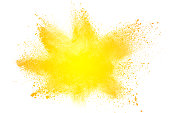 abstract yellow dust explosion on  white background. abstract yellow powder splatter on white background. Freeze motion of yellow powder splash.