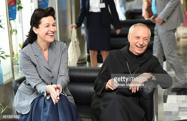 Abtprimas Notker Wolf and Bettina Reitz attend the 'Filmtonart Tag der Filmmusik' Photo Call at Bavarian Funkhaus on June 27 2014 in Munich Germany