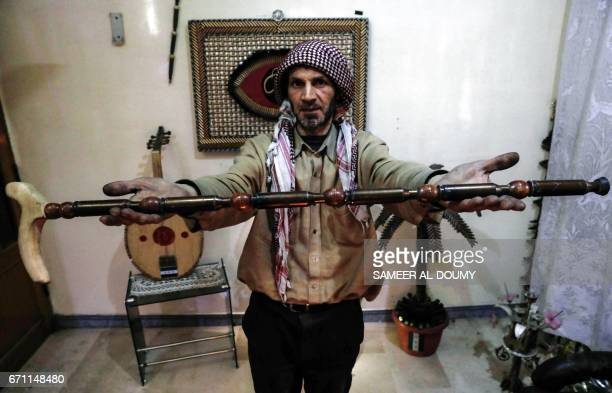 Abu Ali alBitar a 45yearold house painter who collected dozens of rocket debris shows off a cane made of spent ammunition casings in the rebelheld...