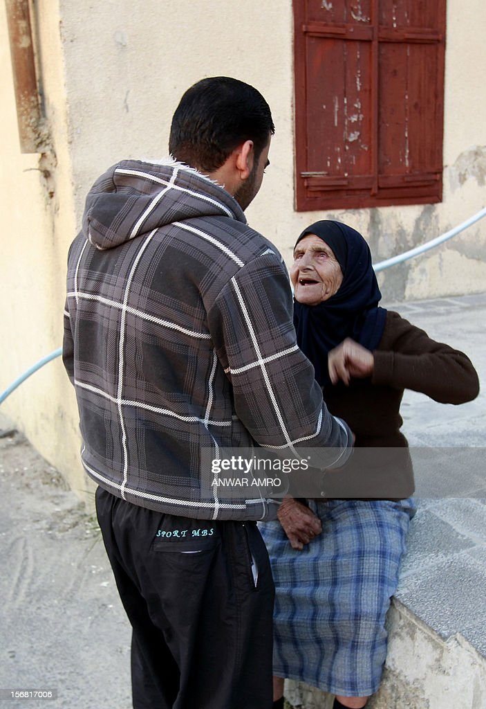 Abu Deeb, 32-year-old Syrian refugee, speaks with his 80-year-old Lebanese aunt, Rashida, in the northern Lebanese town of Halba on November 20, 2012. Syrian refugees in Lebanon are demanding the creation of a camp like in Turkey and Jordan, but the Lebanese government and the United Nations reject the idea. AFP PHOTO / ANWAR AMRO