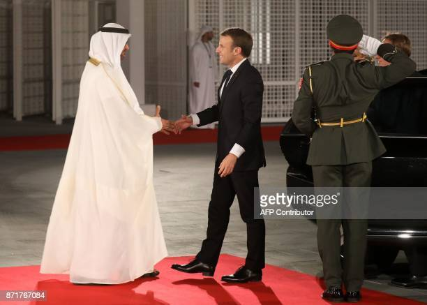 Abu Dhabi Crown Prince Mohammed bin Zayed AlNahyan greets French President Emmanuel Macron at the entrance of the Louvre Abu Dhabi Museum on November...