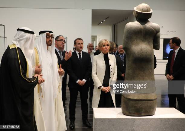 Abu Dhabi Crown Prince Mohammed bin Zayed AlNahyan PresidentDirector of the Louvre Museum JeanLuc Martinez French President Emmanuel Macron and his...