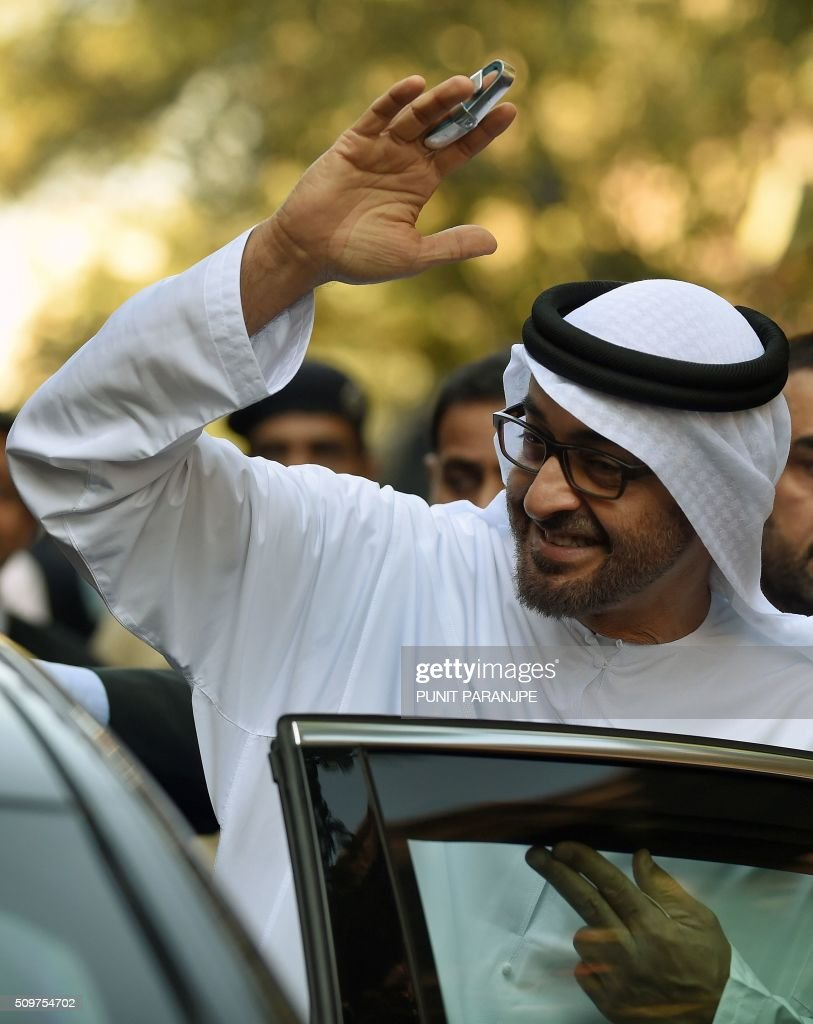 Abu Dhabi Crown Prince Sheikh Mohammed bin Zayed al-Nahyan gestures as he leaves the Bomaby Stock Exchange (BSE) in Mumbai on February 12, 2016. The crown prince is on a three-day state visit to India. AFP PHOTO / PUNIT PARANJPE / AFP / PUNIT PARANJPE