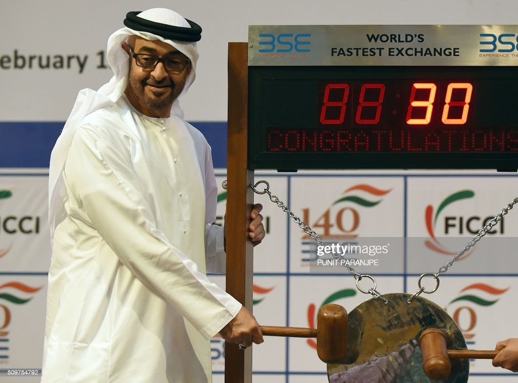 Abu Dhabi Crown Prince Sheikh Mohammed bin Zayed al-Nahyan strikes a gong to end the day's trading at the Bomaby Stock Exchange (BSE) in Mumbai on February 12, 2016. The crown prince is on a three-day state visit to India. AFP PHOTO / PUNIT PARANJPE / AFP / PUNIT PARANJPE