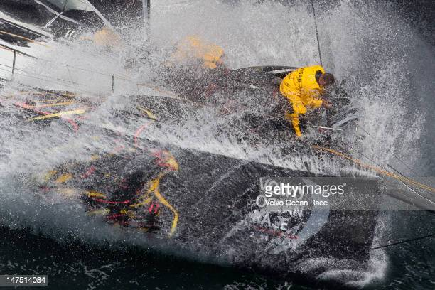 Abu Dhabi Ocean Racing's crew work to change sails whilst getting pounded by waves at the start of leg 9 of the Volvo Ocean Race from Lorient France...