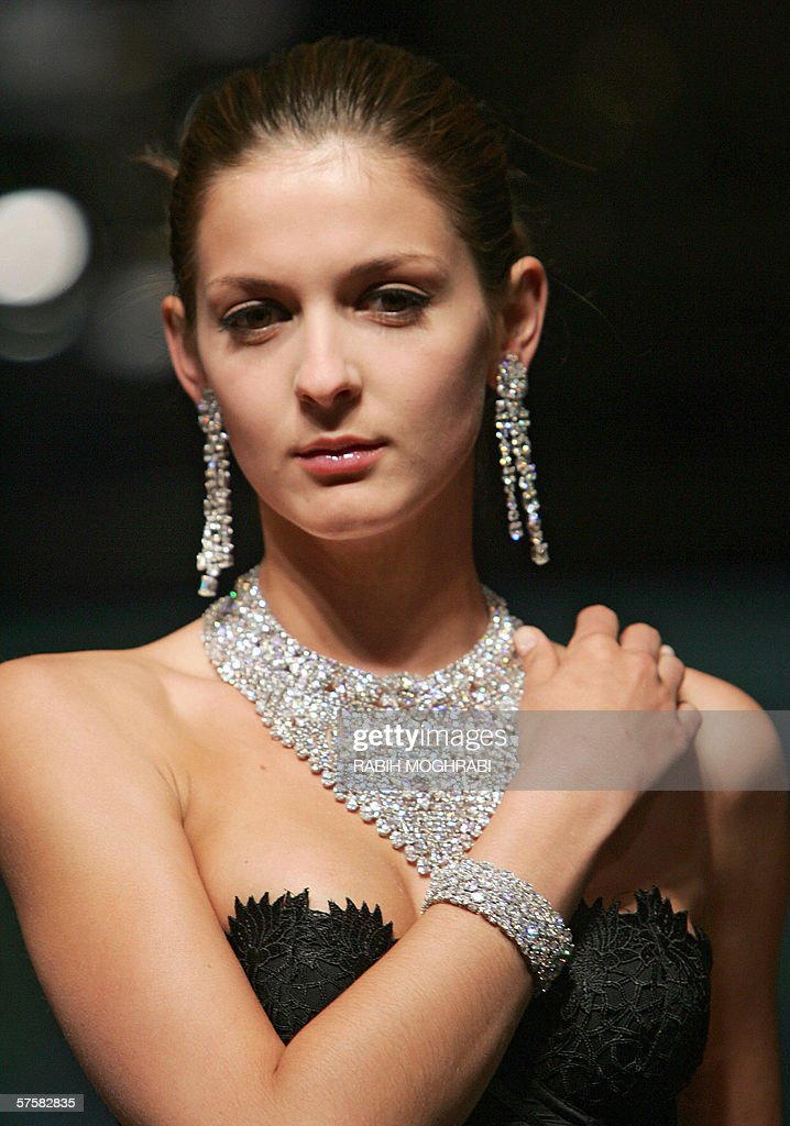 A model displays jewellery by British designer Graff, the world renowned diamond jewellery house, during the third day of the luxury goods fair known as 'Masters of Excellence' in Abu Dhabi 10 May 2006. Thirty-six models flown from Europe are taking part in the four-day exhibition featuring top names in haute couture showing their latest creations and other luxury items ranging from jewelry to yachts.