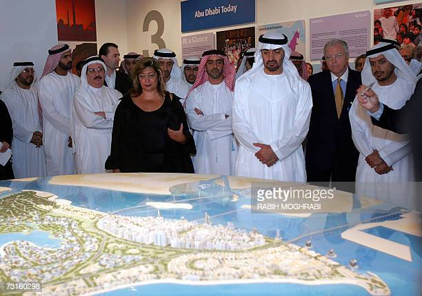 Crown Prince of Abu Dhabi Sheikh Mohammed bin Zayed alNahayan looks at the project model for Saadiyat Island with Iraqiborn British architect Zaha...