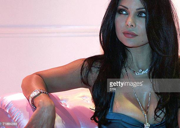 Lebanese singer Haifa Wehbi displays items from the new Cartier jewellery collection at the Emirates Palace hotel in Abu Dhabi late 13 September 2006...