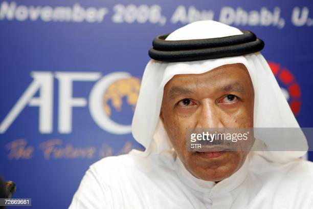 President of the Asian Football Confederation Mohammed bin Hammam poses during an official ceremony with ART chairman Sheikh Mohieddin Saleh Kamal in...