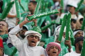 Young fans cheer for the Saudi team during the 18th Gulf Cup football match with Bahrain in Abu Dhabi 18 January 2007 The 18th Gulf Cup tournament...