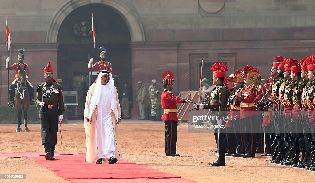 Abu Dhabi's Crown Prince Sheikh Mohammed bin Zayed Al Nahyan (C) salutes honor guards on his arrival at the Indian presidential palace for a ceremonial reception, in New Delhi, India on February 11, 2016. Nahyan is on a three-day visit to India.