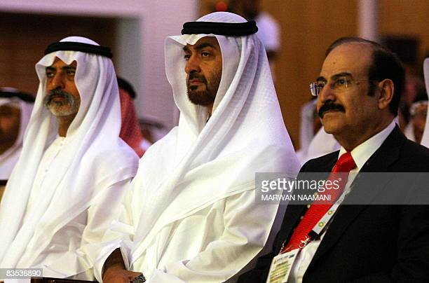 Abu Dhabi's Crown Prince Sheikh Mohammed bin Zayed alNahayan sits flanked by Bahraini Oil and Gas Minister Abdul Hussein Mirza and Emirati Higher...
