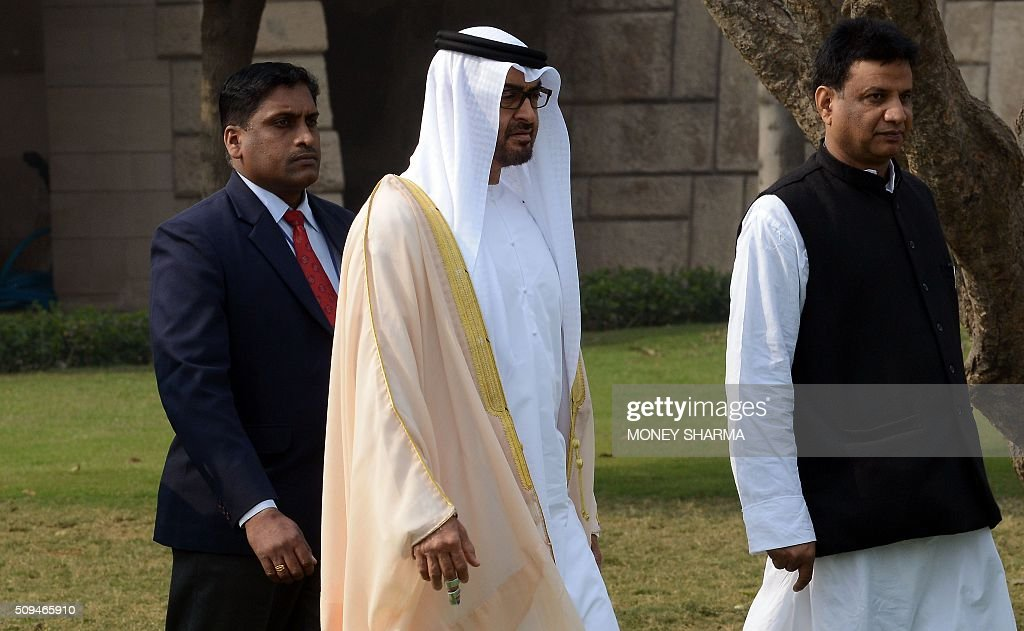 Abu Dhabi's Crown Prince Sheikh Mohammed bin Zayed al-Nahyan (C) arrives during a visit to Raj Ghat, the memorial to the father of the Indian nation Mahatma Gandhi, in New Delhi on February 11, 2016. The crown prince is on three-day state visit to India until February 12. AFP PHOTO / Money SHARMA / AFP / MONEY SHARMA