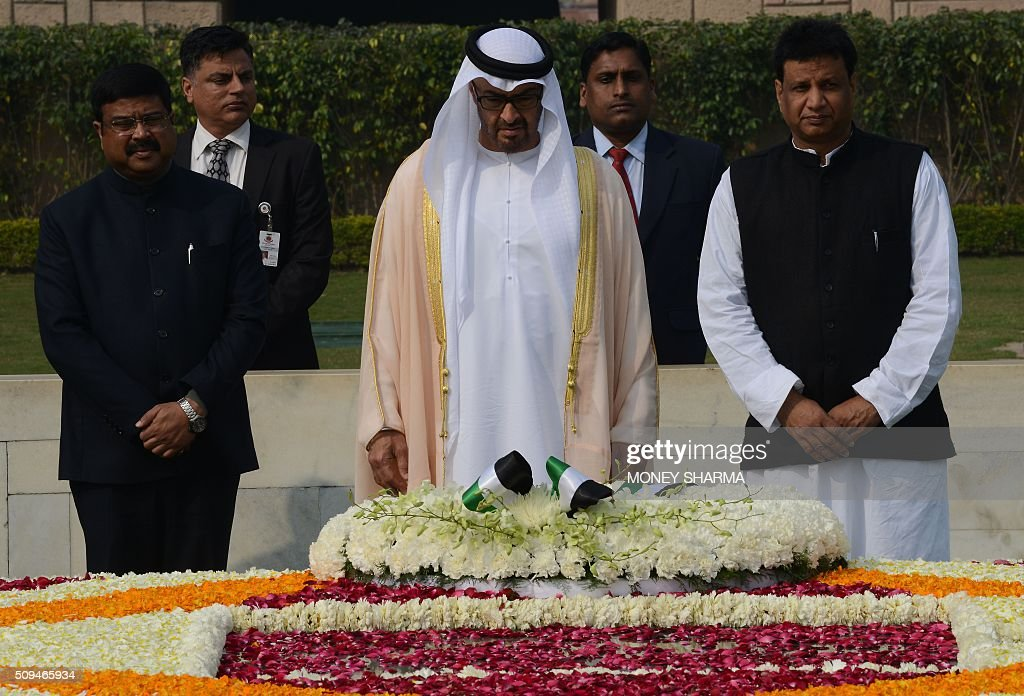 Abu Dhabi's Crown Prince Sheikh Mohammed bin Zayed al-Nahyan (C) during a visit to Raj Ghat, the memorial to the father of the Indian nation Mahatma Gandhi, in New Delhi on February 11, 2016. The crown prince is on three-day state visit to India until February 12. AFP PHOTO / Money SHARMA / AFP / MONEY SHARMA