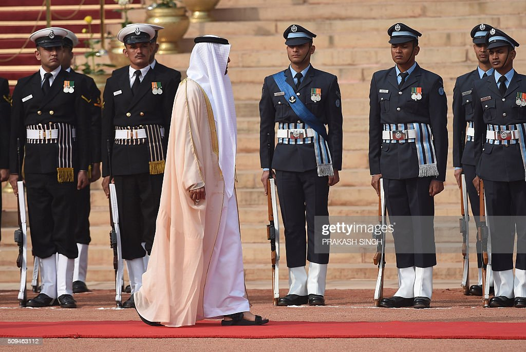 Abu Dhabi's Crown Prince Sheikh Mohammed bin Zayed al-Nahyan (3rd L) inspects a guard of honour during a ceremonial reception at the presidential palace in New Delhi on February 11, 2016. The crown prince is on three-day state visit to India until February 12. AFP PHOTO / Prakash SINGH / AFP / PRAKASH SINGH