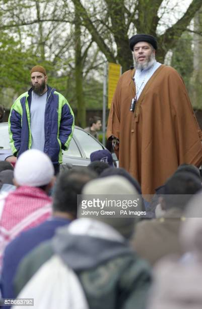 Abu Hamza addresses an audience of more than a 100 muslims during lunchtime prayers outside Finsbury Park Mosque north London