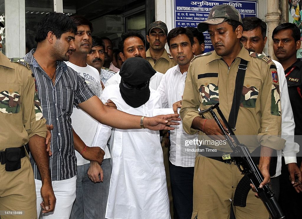 Abu Jundal, his face covered, is taken out of Safdarjung emergency after a routine medical test June 29, 2012 in New Delhi, India. Abu Jundal aka Zabihuddin Ansari, an Indian native operative of Lashkar-e-Taiba, was alleged handler of terrorists in 26/11 terror attack in Mumbai. He was sent to India after being detained in Saudi Arabia.