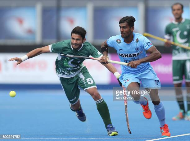 Abu Mahmood of Pakistan and Sumit of India battle for possession during the 5th8th place match between Pakistan and India on day eight of the Hero...