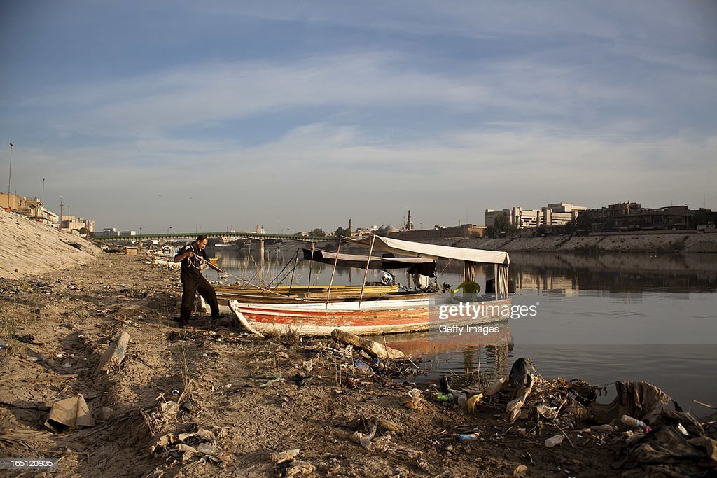 Abu Mustafa prepares a boat on the Tigris river early in the morning on March 29 2013 in Baghdad Iraq Ten years after the regime of Saddam Hussein...