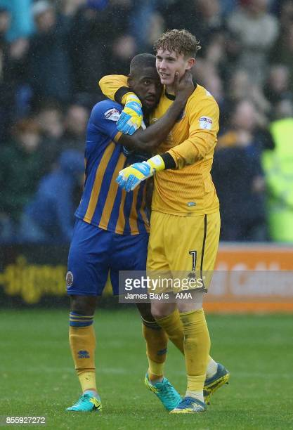 Abu Ogogo of Shrewsbury Town and Dean Henderson of Shrewsbury Town celebrate at full time after the Sky Bet League One match between Shrewsbury Town...