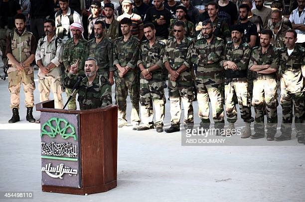 Abu Omar alHanafi the leader of the AlSaif AlOmawi battalion speaks during a cermony where defected officers announced they would join the Islam Army...